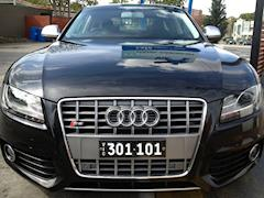 Six digit Mini Heritage number plate mounted on the front of an Audi S5.