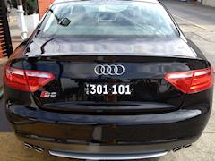 Six digit Mini Heritage number plate mounted on the rear of an Audi S5.