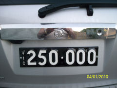 Six digit Heritage number plate mounted on the rear of a Holden Captiva.