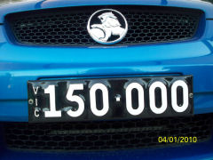 Close up image of a Six digit Heritage number plate mounted on the front of a VE Commodore.